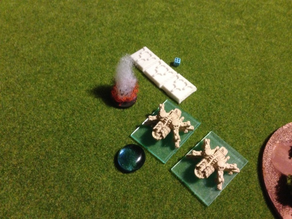 On the flank, Kingdom of Britannia tiny fliers assault the second squadron of Atticus walkers... more wreckage litters the field.